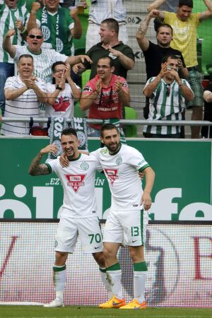 l first: BUDAPEST, HUNGARY - MAY 30, 2015: Roland Ugrai of Ferencvaros (l) and Daniel Bode celebrate the first goal during Ferencvaros vs. Videoton OTP Bank League football match in Groupama Arena.