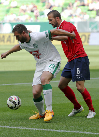 bode: BUDAPEST HUNGARY  MAY 30 2015: Daniel Bode of Ferencvaros l covers the ball from Andras Fejes of Videoton during Ferencvaros vs. Videoton OTP Bank League football match in Groupama Arena.