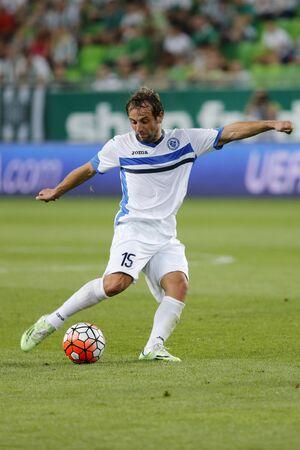 qualifier: BUDAPEST, HUNGARY - JULY 16, 2015: Ognjen Djelmic of Zeljeznicar shoots on target during Ferencvaros vs. Zeljeznicar UEFA EL qualifier football match in Groupama Arena.