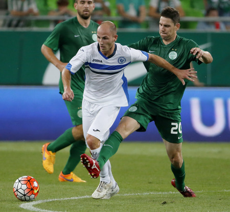 BUDAPEST, HUNGARY - JULY 16, 2015: Zoltan Gera of Ferencvaros (r) tries to tackle Jovan Blagojevic of Zeljeznicar during Ferencvaros vs. Zeljeznicar UEFA EL qualifier football match in Groupama Arena. Sajtókép