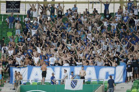 uefa: BUDAPEST, HUNGARY - JULY 16, 2015: Fans of Zeljeznicar during Ferencvaros vs. Zeljeznicar UEFA EL qualifier football match in Groupama Arena.