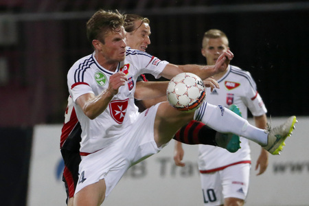 patrik: BUDAPEST, HUNGARY - JULY 18, 2015: Duel between Patrik Hidi of Honved (r) and Kees Luijckx of Videoton during Honved vs. Videoton OTP Bank League football match in Bozsik Stadium. Editorial