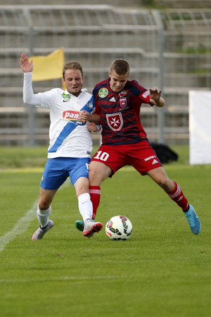 teammate: BUDAPEST, HUNGARY - AUGUST 23, 2015: Duel between Szabolcs Varga of MTK (l) and Istvan Kovacs of Videoton during MTK vs. Videoton OTP Bank League football match in Illovszky Stadium. Editorial