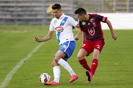 barnabas: BUDAPEST, HUNGARY - AUGUST 23, 2015: Duel between Barnabas Bese of MTK (l) and Adam Gyurcso of Videoton during MTK vs. Videoton OTP Bank League football match in Illovszky Stadium.