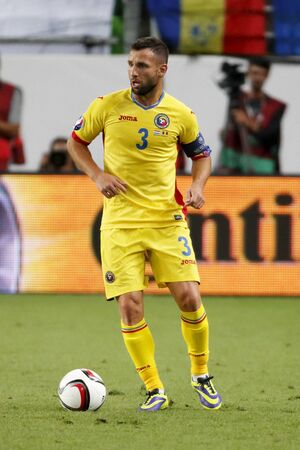 qualifier: BUDAPEST, HUNGARY - SEPTEMBER 4, 2015: Romanian Razvan Rat with the ball during Hungary vs. Romania UEFA Euro 2016 qualifier football match in Groupama Arena. Editorial
