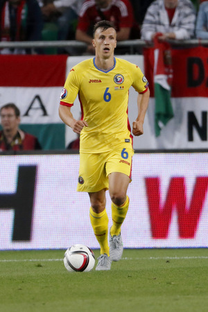 uefa: BUDAPEST, HUNGARY - SEPTEMBER 4, 2015: Romanian Vlad Chiriches with the ball during Hungary vs. Romania UEFA Euro 2016 qualifier football match in Groupama Arena. Editorial