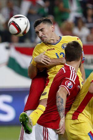 uefa: BUDAPEST, HUNGARY - SEPTEMBER 4, 2015: Romanian Claudiu Keseru is embranced after corner kick during Hungary vs. Romania UEFA Euro 2016 qualifier football match in Groupama Arena.