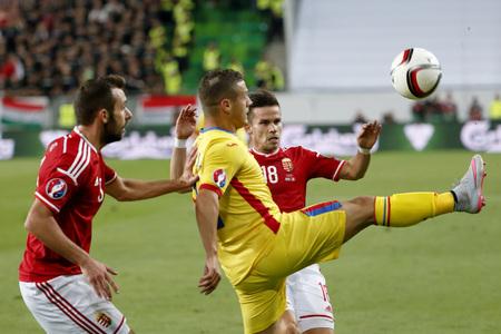 qualifier: BUDAPEST, HUNGARY - SEPTEMBER 4, 2015: Between Hungarian Attila Fiola (l) and Zoltan Stieber (18) kicks the ball Romanian Gabriel Torje during Hungary vs. Romania UEFA Euro 2016 qualifier football match in Groupama Arena.