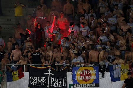 ultras: BUDAPEST, HUNGARY - SEPTEMBER 4, 2015: Romanian fans set fire during Hungary vs. Romania UEFA Euro 2016 qualifier football match in Groupama Arena.