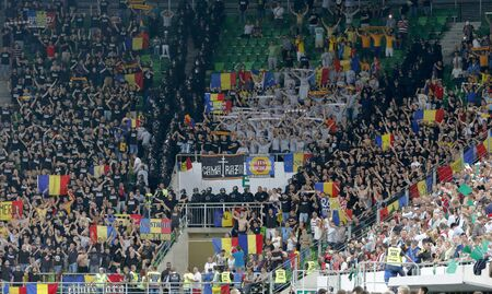 qualifier: BUDAPEST, HUNGARY - SEPTEMBER 4, 2015: Romanian fans during Hungary vs. Romania UEFA Euro 2016 qualifier football match in Groupama Arena.