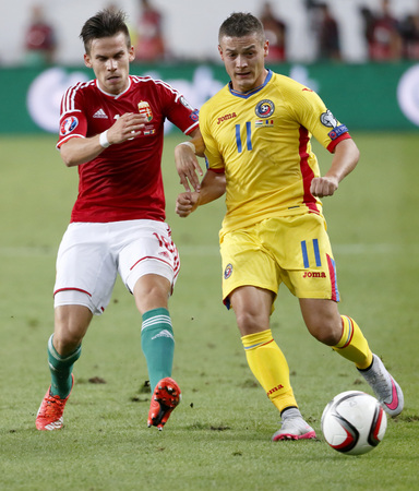 qualifier: BUDAPEST, HUNGARY - SEPTEMBER 4, 2015: Duel between Hungarian Zoltan Stieber (l) and Romanian Gabriel Torje during Hungary vs. Romania UEFA Euro 2016 qualifier football match in Groupama Arena.