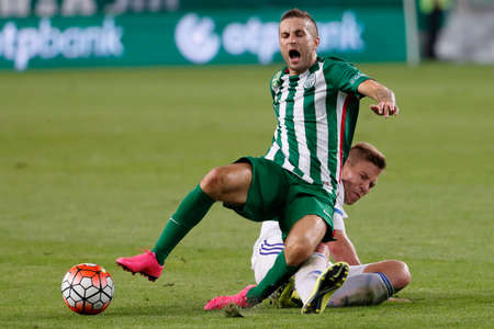 tripped: BUDAPEST, HUNGARY - SEPTEMBER 19, 2015: Stanislav Sestak of Ferencvaros (l) is tripped up by Adam Viczian of Bcsaba during Ferencvaros vs. Bekescsaba OTP Bank League football match in Groupama Arena.