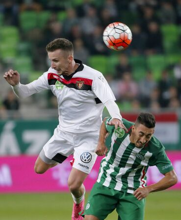 richard: BUDAPEST, HUNGARY - OCTOBER 3, 2015: Air battle between Leandro De Almeida of Ferencvaros (r) and Richard Vernes of Honved during Ferencvaros vs. Honved OTP Bank League football match in Groupama Arena.