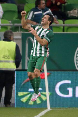 BUDAPEST, HUNGARY - OCTOBER 3, 2015: Tamas Hajnal of Ferencvaros celebrates his equalizer goal during Ferencvaros vs. Honved OTP Bank League football match in Groupama Arena.