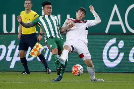 cristian: BUDAPEST, HUNGARY - OCTOBER 3, 2015: Duel between Cristian Ramirez of Ferencvaros (l) and Daniel Gazdag of Honved during Ferencvaros vs. Honved OTP Bank League football match in Groupama Arena.
