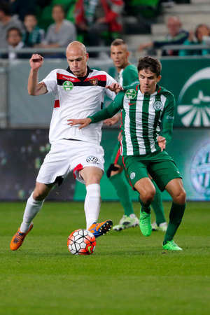 offside: BUDAPEST, HUNGARY - OCTOBER 3, 2015: Duel between Adam Nagy of Ferencvaros (r) and Botond Barath of Honved during Ferencvaros vs. Honved OTP Bank League football match in Groupama Arena.