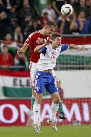 teammate: BUDAPEST, HUNGARY - OCTOBER 8, 2015: Air battle between Hungarian Roland Juhasz (l) and Faroese Roaldur Jakobsen during Hungary vs. Faroe Islands UEFA Euro 2016 qualifier football match in Groupama Arena. Editorial
