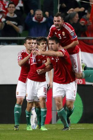 teammates: BUDAPEST, HUNGARY - OCTOBER 8, 2015: Hungarian Daniel Bode (13) celebrates his first goal with his teammates during Hungary vs. Faroe Islands UEFA Euro 2016 qualifier football match in Groupama Arena. Editorial