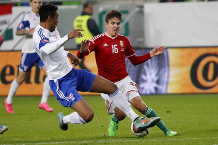qualifier: BUDAPEST, HUNGARY - OCTOBER 8, 2015: Hungarian Adam Nagy (r) is tackled by Faroese Ragnar Nattestad during Hungary vs. Faroe Islands UEFA Euro 2016 qualifier football match in Groupama Arena.