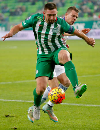 vasas: BUDAPEST, HUNGARY - OCTOBER 31, 2015: Duel between Daniel Bode of Ferencvaros (l) and an unidentified player of Vasas during Ferencvaros vs. Vasas OTP Bank League football match in Groupama Arena. Editorial