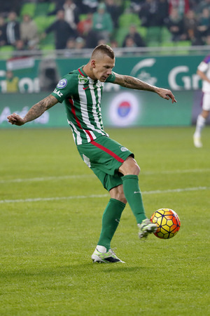 vasas: BUDAPEST, HUNGARY - OCTOBER 31, 2015: Roland Varga of Ferencvaros scores the fifth goal during Ferencvaros vs. Vasas OTP Bank League football match in Groupama Arena.
