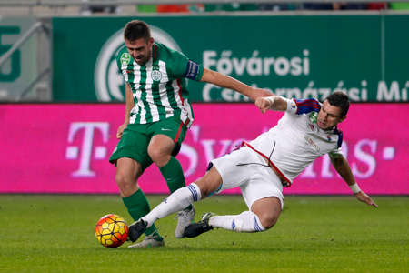 bode: BUDAPEST, HUNGARY - OCTOBER 31, 2015: Duel between Daniel Bode of Ferencvaros (l) and an unidentified player of Vasas during Ferencvaros vs. Vasas OTP Bank League football match in Groupama Arena. Editorial