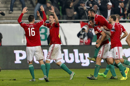 bode: BUDAPEST, HUNGARY - NOVEMBER 15, 2015: Hungarian Richard Guzmics (20), Daniel Bode (13), Attila Fiola and Tamas Kadar (4) celebrate with his teammates the second goal during Hungary vs. Norway UEFA Euro 2016 qualifier play-off football match at Groupama A