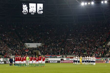 teammate: BUDAPEST, HUNGARY - NOVEMBER 15, 2015: Hungarian, Norwegian national teams and the crows remember of the victims of terror attack in Paris, and two Hungarian football legends, Pal Varhidi and Marton Fulop during Hungary vs. Norway UEFA Euro 2016 qualifier