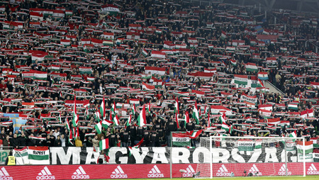 BUDAPEST, HUNGARY - NOVEMBER 15, 2015: Hungarian fans listen to the national anthem during Hungary vs. Norway UEFA Euro 2016 qualifier play-off football match at Groupama Arena.