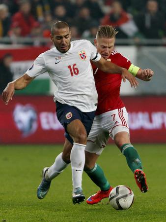 qualifier: BUDAPEST, HUNGARY - NOVEMBER 15, 2015: Duel between Hungarian Balazs Dzsudzsak r and Norwegian Haitam Aleesami during Hungary vs. Norway UEFA Euro 2016 qualifier play-off football match at Groupama Arena.