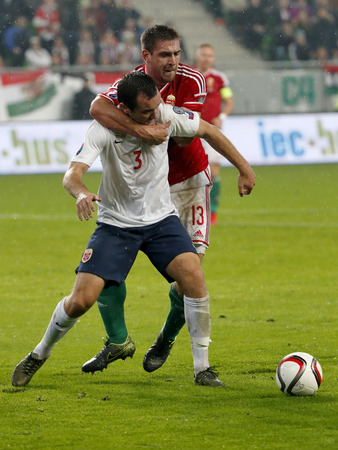 bode: BUDAPEST, HUNGARY - NOVEMBER 15, 2015: Duel between Hungarian Daniel Bode r and Norwegian Even Hovland during Hungary vs. Norway UEFA Euro 2016 qualifier play-off football match at Groupama Arena.