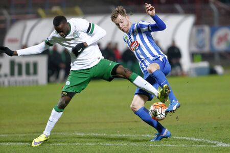 BUDAPEST, HUNGARY - NOVEMBER 21, 2015: Marek Strestik of MTK (r) is attacked by Roland Lamah of Ferencvaros during MTK Budapest - Ferencvaros OTP Bank League football match at Illovszky Stadium.