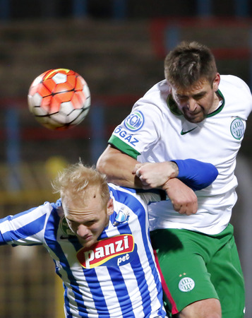 bode: BUDAPEST, HUNGARY - NOVEMBER 21, 2015: Air battle between Patrik Poor of MTK (l) and Daniel Bode of Ferencvaros during MTK Budapest - Ferencvaros OTP Bank League football match at Illovszky Stadium.
