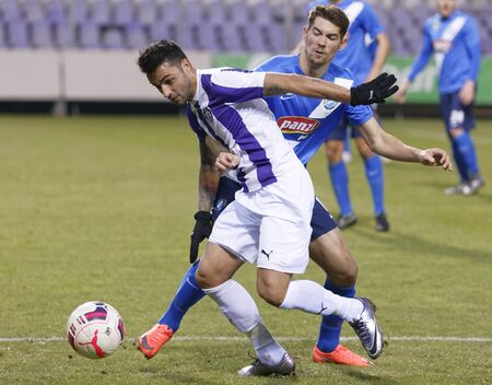 barnabas: BUDAPEST, HUNGARY - FEBRUARY 20, 2016: Duel between Laszlo Lencse of Ujpest (l) and Barnabas Bese of MTK during Ujpest - MTK Budapest OTP Bank League football match at Szusza Stadium.