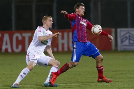 vasas: BUDAPEST, HUNGARY - MARCH 8, 2016: Martin Adam of Vasas (r) covers the ball from Csaba Szatmari of DVSC during Vasas - DVSC-TEVA OTP Bank League football match at Illovszky Stadium. Editorial