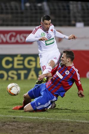 vasas: BUDAPEST, HUNGARY - MARCH 8, 2016: Zsolt Korcsmar of Vasas (r) slides against Tibor Tisza of DVSC during Vasas - DVSC-TEVA OTP Bank League football match at Illovszky Stadium. Editorial
