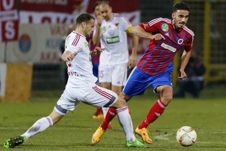 vasas: BUDAPEST, HUNGARY - MARCH 8, 2016: Dusan Brkovic of DVSC tries to stop Ilias Ignatidis of Vasas (r) and  during Vasas - DVSC-TEVA OTP Bank League football match at Illovszky Stadium. Editorial