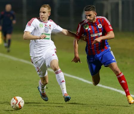 vasas: BUDAPEST, HUNGARY - MARCH 8, 2016: Duel between Ilias Ignatidis of Vasas (r) and Csaba Szatmari of DVSC during Vasas - DVSC-TEVA OTP Bank League football match at Illovszky Stadium. Editorial