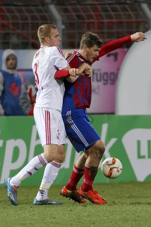 vasas: BUDAPEST, HUNGARY - MARCH 8, 2016: Duel between Martin Adam of Vasas (r) and Csaba Szatmari of DVSC during Vasas - DVSC-TEVA OTP Bank League football match at Illovszky Stadium.