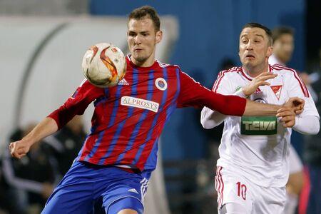 vasas: BUDAPEST, HUNGARY - MARCH 8, 2016: Duel between Zsolt Korcsmar of Vasas (l) and Tibor Tisza of DVSC during Vasas - DVSC-TEVA OTP Bank League football match at Illovszky Stadium. Editorial