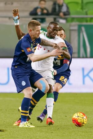 BUDAPEST, HUNGARY - MARCH 12, 2016: Roland Lamah of Ferencvaros (m) is fouled by Stipe Bacelic-Grgic (l) and Attila Fiola of Puskas during Ferencvaros - Puskas Akademia OTP Bank League football match at Groupama Arena. Editorial