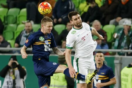 BUDAPEST, HUNGARY - MARCH 12, 2016: Air battle between Daniel Bode of Ferencvaros (r) and Stipe Bacelic-Grgic of Puskas during Ferencvaros - Puskas Akademia OTP Bank League football match at Groupama Arena. Editorial