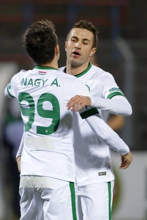 vasas: BUDAPEST, HUNGARY - MARCH 19, 2016: Stanislav Sestak of Ferencvaros is celebrated after his score during Vasas - Ferencvaros OTP Bank League football match at Illovszky Stadium.
