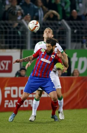 vasas: BUDAPEST, HUNGARY - MARCH 19, 2016: Duel between Mohamed Remili of Vasas (l) and Emir Dilaver of Ferencvaros during Vasas - Ferencvaros OTP Bank League football match at Illovszky Stadium.