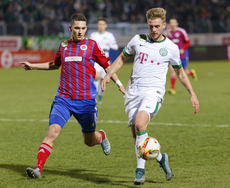 vasas: BUDAPEST, HUNGARY - MARCH 19, 2016: Mate Vida of Vasas (l) follows Florian Trinks of Ferencvaros during Vasas - Ferencvaros OTP Bank League football match at Illovszky Stadium.