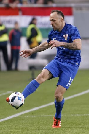 teammate: BUDAPEST, HUNGARY - MARCH 26, 2016: Croatian Gordon Schildenfeld is with the ball during Hungary vs. Croatia international friendly football match in Groupama Arena. Editorial