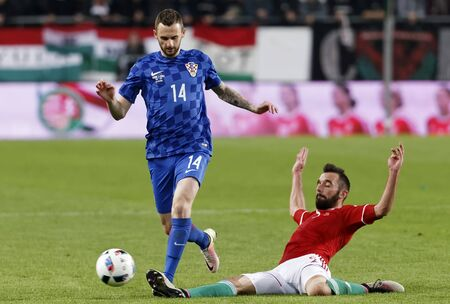 teammate: BUDAPEST, HUNGARY - MARCH 26, 2016: Hungarian Attila Fiola (r) tries to tackle Croatian Marcelo Brozovic during Hungary vs. Croatia international friendly football match in Groupama Arena. Editorial