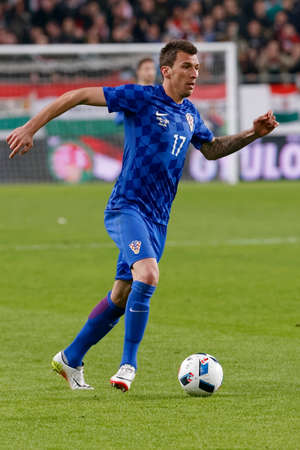 mario: BUDAPEST, HUNGARY - MARCH 26, 2016: Croatian Mario Mandzukic is with the ball during Hungary vs. Croatia international friendly football match in Groupama Arena. Editorial