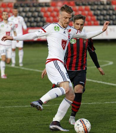 BUDAPEST, HUNGARY - APRIL 2, 2016: Zsolt Haraszti of Videoton covers the ball from Gergo Nagy of Honved (r) and during Budapest Honved - Videoton OTP Bank League football match at Bozsik Stadium.