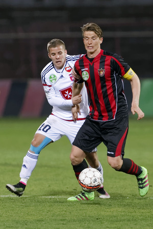 BUDAPEST, HUNGARY - APRIL 2, 2016: Patrik Hidi of Honved (r) and Istvan Kovacs of Videoton during Budapest Honved - Videoton OTP Bank League football match at Bozsik Stadium.